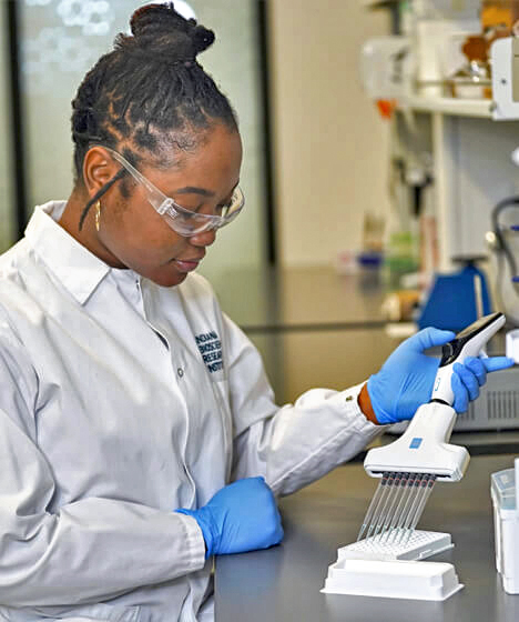 researcher filling pipets